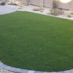 Backyard residence after synthetic grass installation